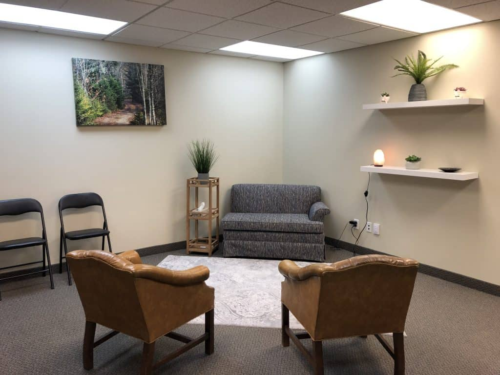 Two chairs and couch Inside therapy office for 195 King St Suite 103, Cameron Counselling