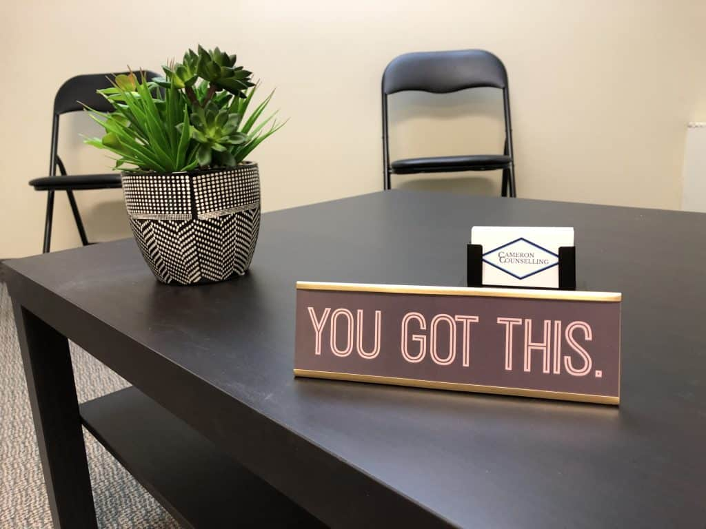 Inside therapy office showing motivational sign for 195 King St Suite 103, Cameron Counselling